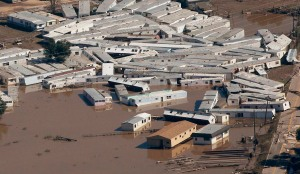 Portable buildings lie piled together by flooding in a town in Weld County, Colorado